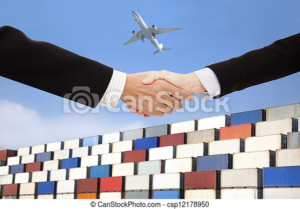 international business trade and transportation concept.businessman and businesswoman handshaking with containers background - csp12178950