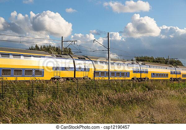 Dutch train in rural landscape - csp12190457