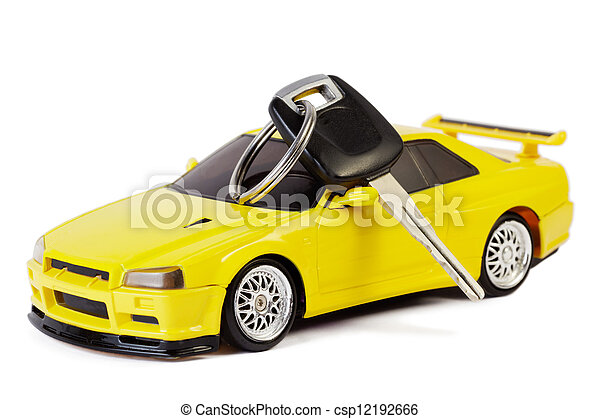 Car key lays on the yellow toy car, isolated on white - csp12192666
