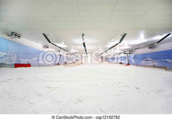 Empty indoor lighting ski; many white snow; funicular; place for active recreation