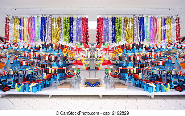 Shelves with variety of agriculture instruments inside large supermarket - csp12192829