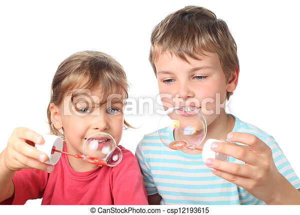 little brother and sister sitting, smiling and blowing bubbles isolated on white - csp12193615