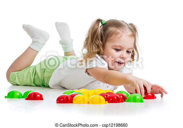 Cute child playing with  mosaic toy - csp12198660