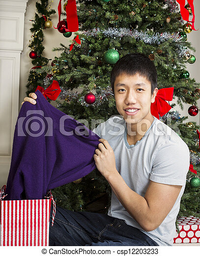 Young Adult Man with Holiday Gifts  - csp12203233