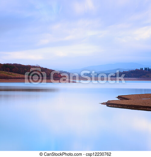 Mountain lake landscape in a cold atmosphere. - csp12230762