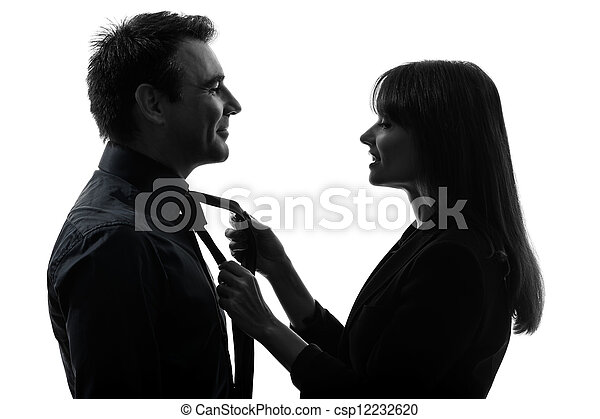 couple woman helping man tying silhouette - csp12232620