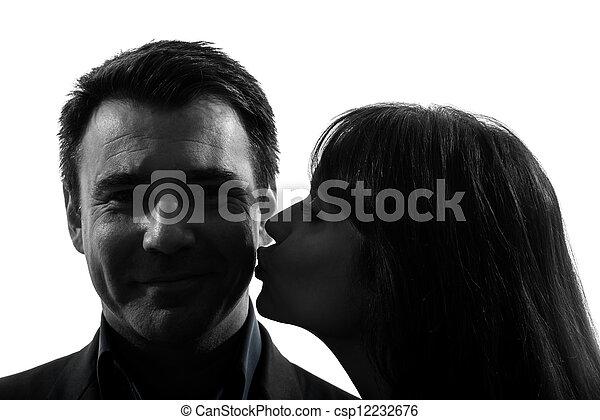 couple woman kissing man silhouette - csp12232676