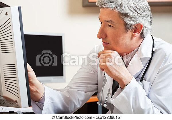 Doctor Looking At Computer Screen - csp12239815