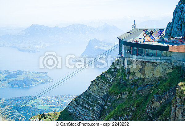 LUCERNE, SWITZERLAND - SEPTEMBER 11:  A view from the mountain Pilatus on September 11, 2011 in Switzerland. The top (2, 128 m) can be reached the whole year with aerial cableways from Kriens. - csp12243232