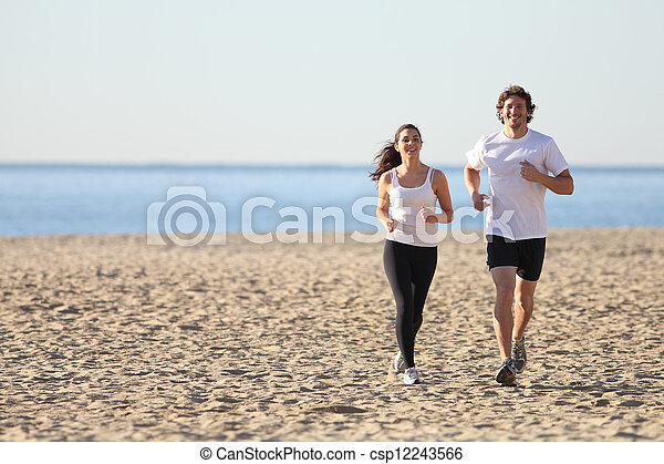 Man and woman running in the beach - csp12243566