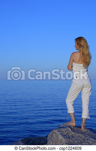 Calm young woman looking at the sea - csp1224609
