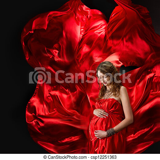 Pregnant woman in red evening dress flying on wind - csp12251363