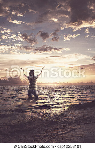 Woman praising in the ocean - csp12253101