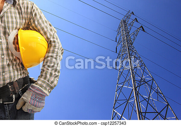 Electrician and high voltage power pylon against blue sky  - csp12257343