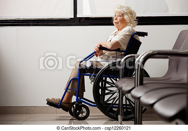 Pensive Elderly Woman On Wheelchair - csp12260121