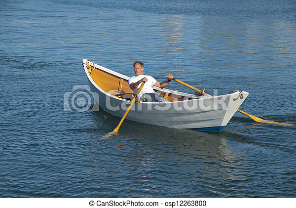 Stock Photography of Man rowing a dory boat - Man rowing a ...