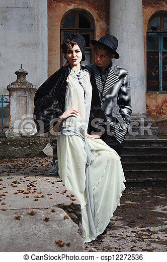 Retro styled fashion portrait of a young couple. - csp12272536