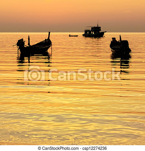 Gold sunset with longtail boats on tropical beach. Ko Tao island, Thailand - csp12274236