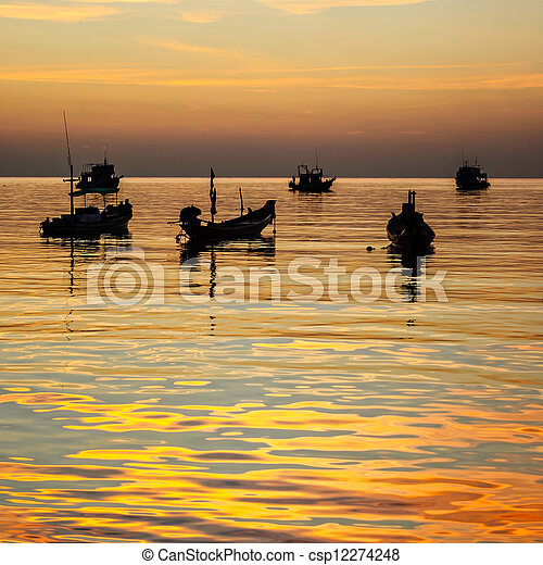 Sunset with long-tail boats on tropical beach. Ko Tao island, Thailand - csp12274248
