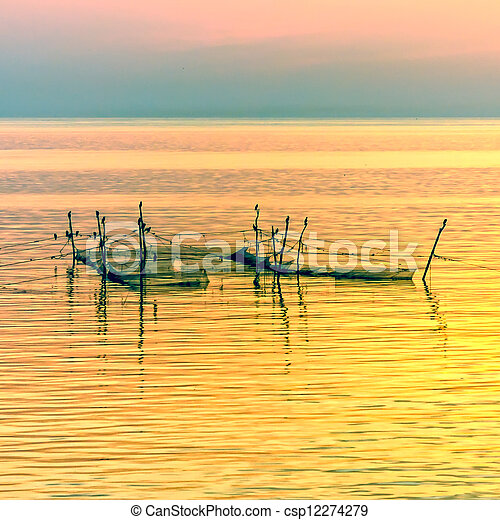 Sunset with long-tail boats on tropical beach. Ko Tao island, Thailand. - csp12274279