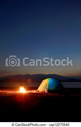 tent and campfire at sunset, beside the lake - csp12275540