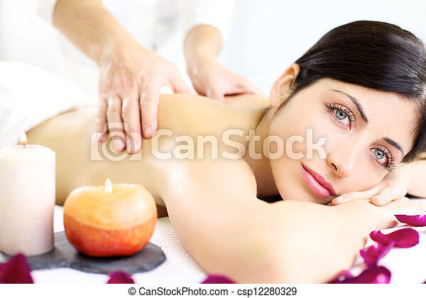 Young woman getting back massage in luxury spa - csp12280329