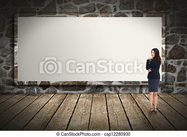 Business woman near billboard. - csp12280930