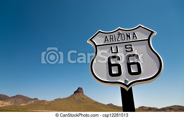 A view of a historic Route 66 sign with a sky blue background - csp12281513