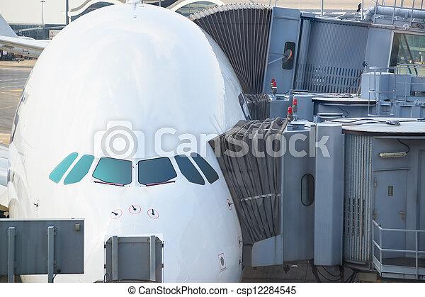 Jetway bridges and airplane waiting boarding - csp12284545