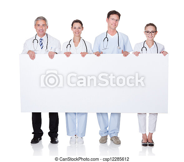 Medical staff holding up a white banner - csp12285612