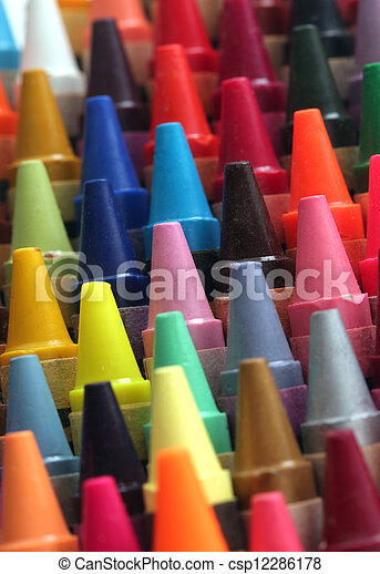 Colorful art wax crayon pencils tips for children and others arranged attractively in rows and columns making a stunning display of colors - csp12286178
