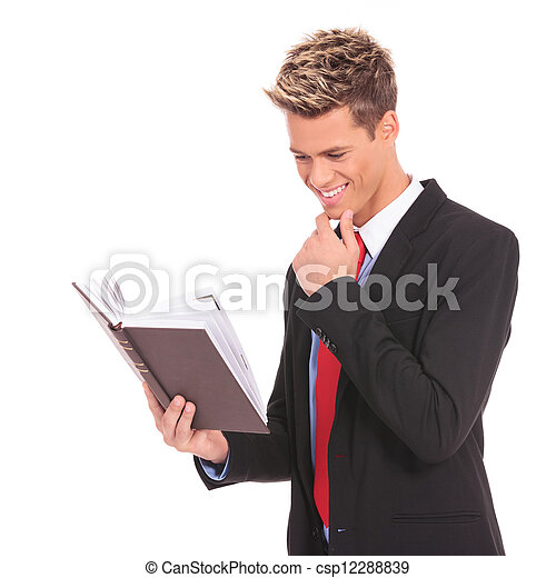 young student  reading a law book - csp12288839