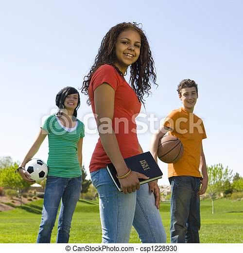 Three teens with bible - csp1228930
