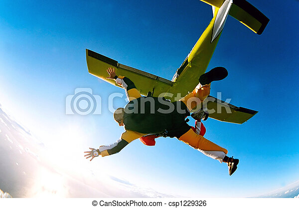 Tandem skydivers in action - csp1229326