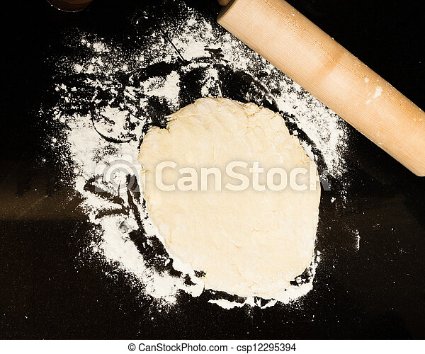 Making biscuits with rolling pin and dough - csp12295394