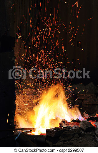 Stock Photography of forge fire in blacksmiths where iron tools are crafted