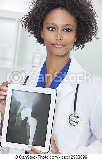 African American Woman Doctor X-Ray Tablet Computer  - csp12303099