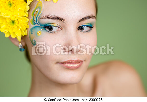 Young girl model with fantasy makeup and chrysanthemum flowers in her hair - csp12309075