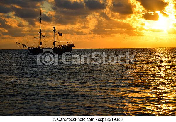 Pirate Ship Sunrise - csp12319388