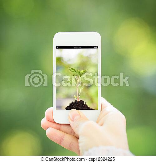 Woman hand holding smart phone - csp12324225