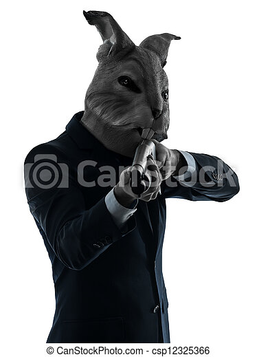 man with rabbit mask hunting with shotgun silhouette portrait - csp12325366
