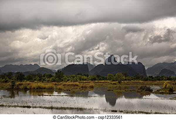 monsoon rains over a arrzoal in laos - csp12333561
