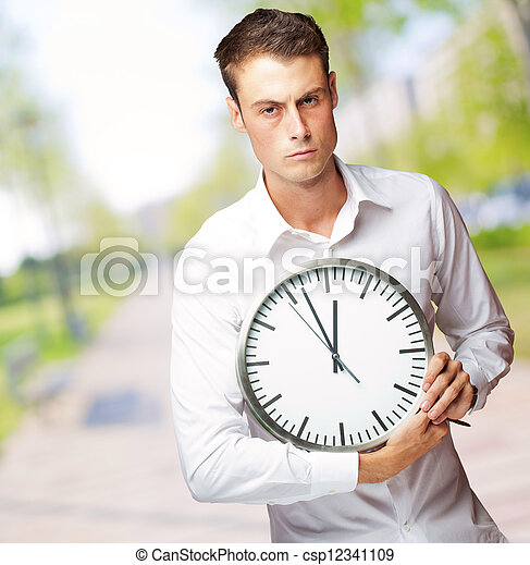 Angry Man Holding A Clock