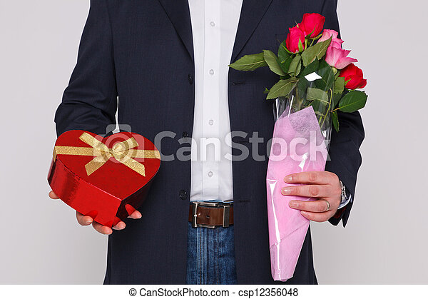 Man holding flowers and a box of chocolates - csp12356048