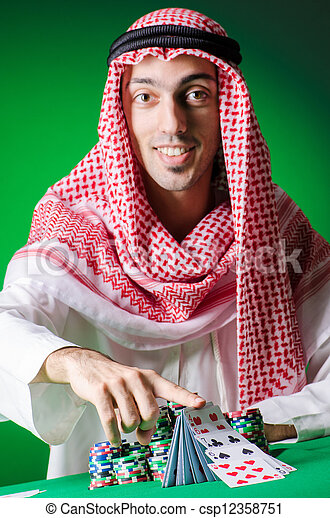 Arab playing in casino - gambling concept with man - csp12358751