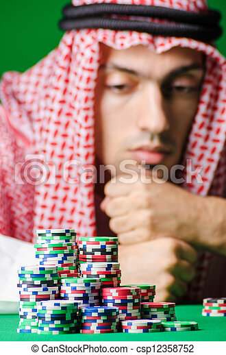 Arab playing in casino - gambling concept with man - csp12358752