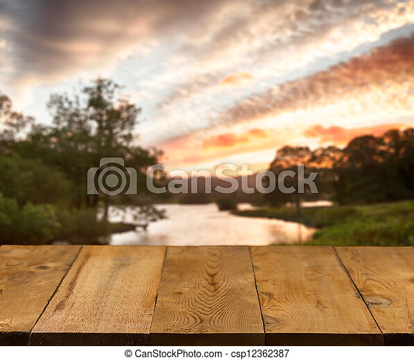 Old wooden table or walkway by lake - csp12362387
