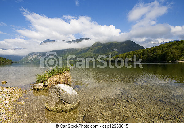 Scenic view of crystal clear lake Bohinj - csp12363615