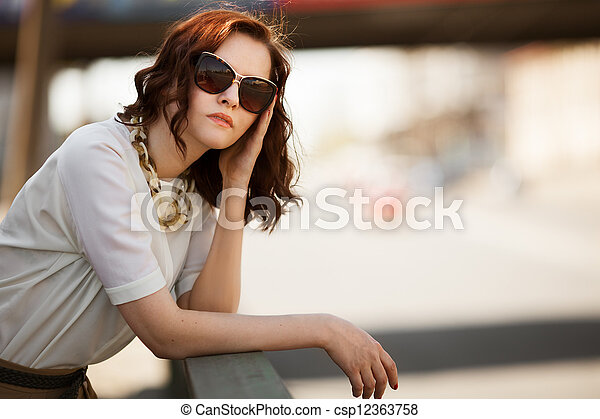 Fashion model wearing sunglasses outdoors closeup portrait - csp12363758