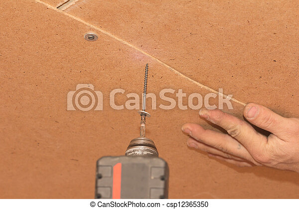 stock bilder von straffen schrauben holz wand csp12365350 suchen sie fotos abbildungen. Black Bedroom Furniture Sets. Home Design Ideas